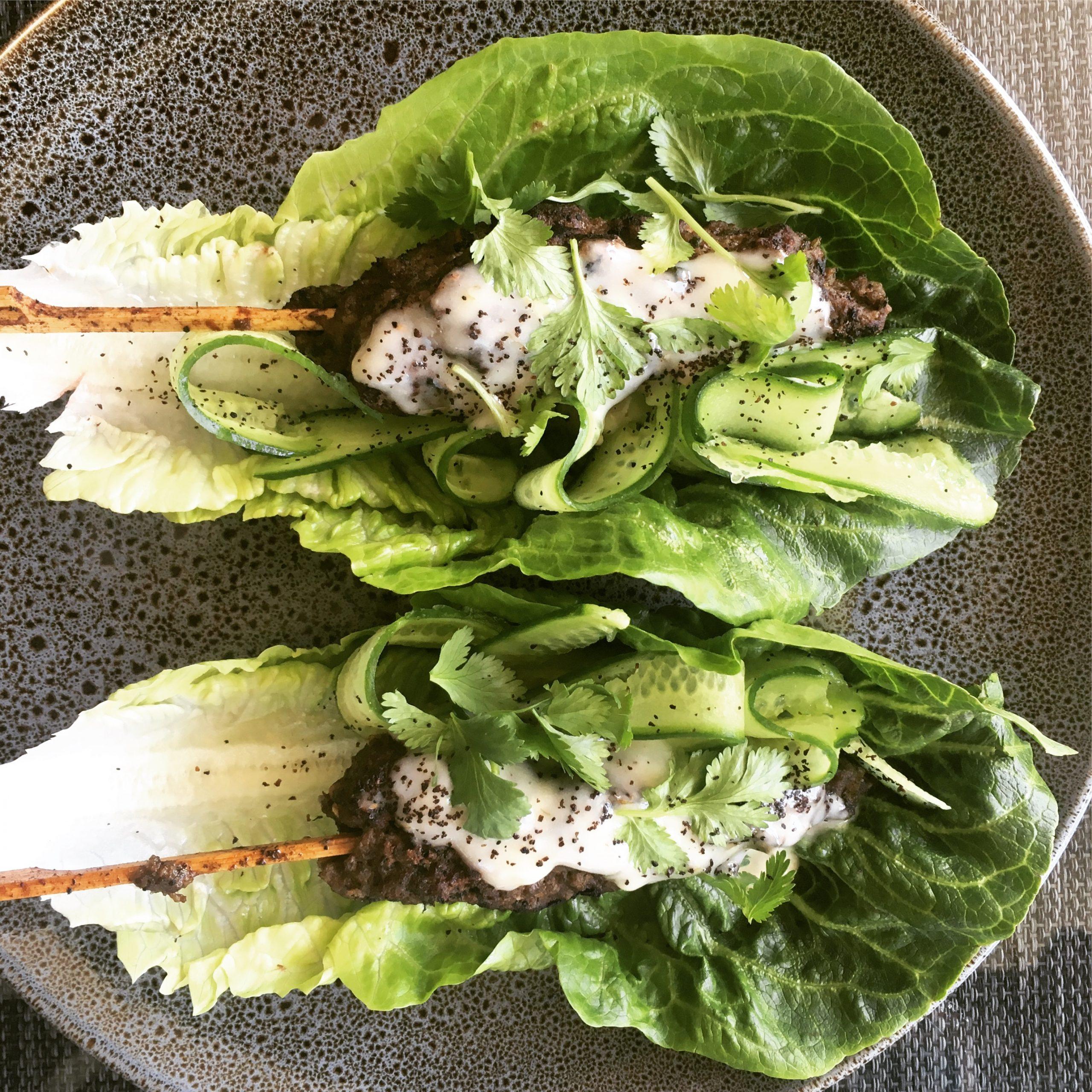 Beef koftas with yoghurt dressing on lettuce wraps